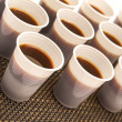 Disposable cups with coffee — Stock Photo