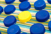 Plastic lids, one in a different color — Stock Photo