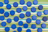 Plastic lids background — Stock Photo