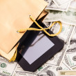 Gold gift bag with Tablet and dollars — Foto de stock #30262439