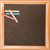 Backboard with chalks — Stock Photo