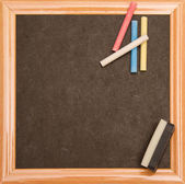 Backboard with chalks and board rubber — Stockfoto