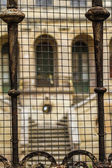 Mansion with oxidized bars — Stock Photo