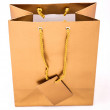 Stock Photo: Gold gift bag