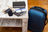 Airline ticket, passport and luggage — Stock Photo