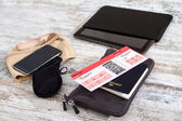 Airline ticket, passport and electronics — Stockfoto