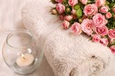 Roses with a candle — Stock Photo