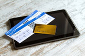 Buying Airline tickets on a tablet — Stock Photo