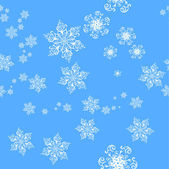 Seamless background of snowflakes — Stock Vector