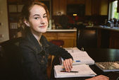Teenager studying at home — Stock Photo