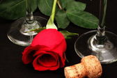 Romantic Rose with champagned flutes — Stock Photo