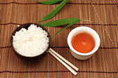 Tea, rice and chopsticks — Stock Photo