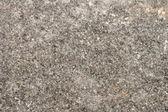 Ruwe grijze stenen achtergrond — Stockfoto