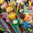 Plastic flowers made from drinking straws — Stock Photo #33389407