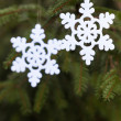 Snoflake decoration on pine tree — Stock Photo #35249007
