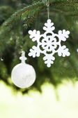 Pine tree and white buble with snoflake — Stock Photo
