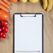 Notebook with vegetables — Stock Photo