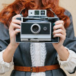 Retro photo camera woman with red hair — Zdjęcie stockowe