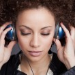 Young woman with headphones — Stock Photo #36709451