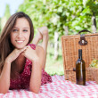 Happy young woman having a picnic — Stock Photo