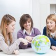 Teenagers Looking a Globe — Stock Photo