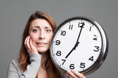 Young woman running out of time — Stock Photo