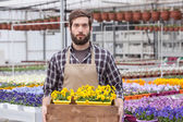 Young adult male florist — Stock Photo