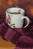 Hot Cup Of Tea With Scarf — Stock Photo