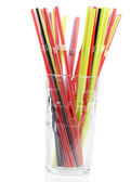 Glass with colorful straws — Stock Photo