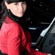 Charming young woman in a car — Stock Photo #24386607