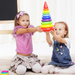 Two little girls play with toys — Stock Photo