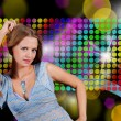 Stock Photo: Charming young blonde on abstract background