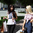 Two charming young woman going shopping — Lizenzfreies Foto