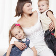Mom playing with young children — Stock Photo #24387359