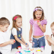 Young children painting — Stock Photo