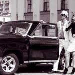 A young couple with a retro car — Stock Photo