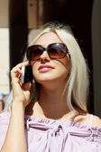 Charming young blonde talking on the phone — Stock Photo
