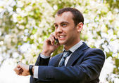 Young businessman speaking on phone outdoor — Stock Photo