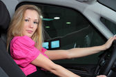 Charming blonde in the car — Stock Photo