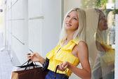 Charming young woman going shopping — Stock Photo