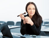 Attractive businesswoman with brush for make-up — Stock Photo