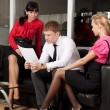 The young businessman at office with colleagues — Stock Photo