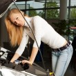 Young woman repairing her car — Stock Photo