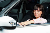 Charming young woman sitting in a car — Stock Photo