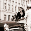 A young couple with a retro car — Stock Photo