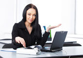 Business woman at her workplace — Stock Photo
