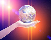 Planet earth in woman's hand — Stock Photo