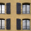 Stock Photo: Four windows on frontage of house