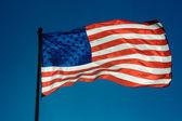 USA flag against a blue sky — Stock Photo