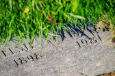 Old horizontal gravestone in the ground — Stock Photo